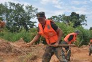 抗洪战士罗杰:22年前洪灾中获救的男孩